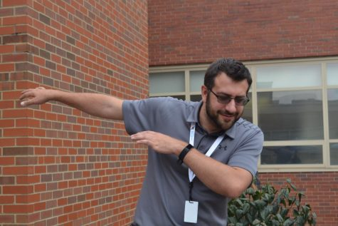 Swim coach, Mr. Modrak, dabs in excitement for PSLs!