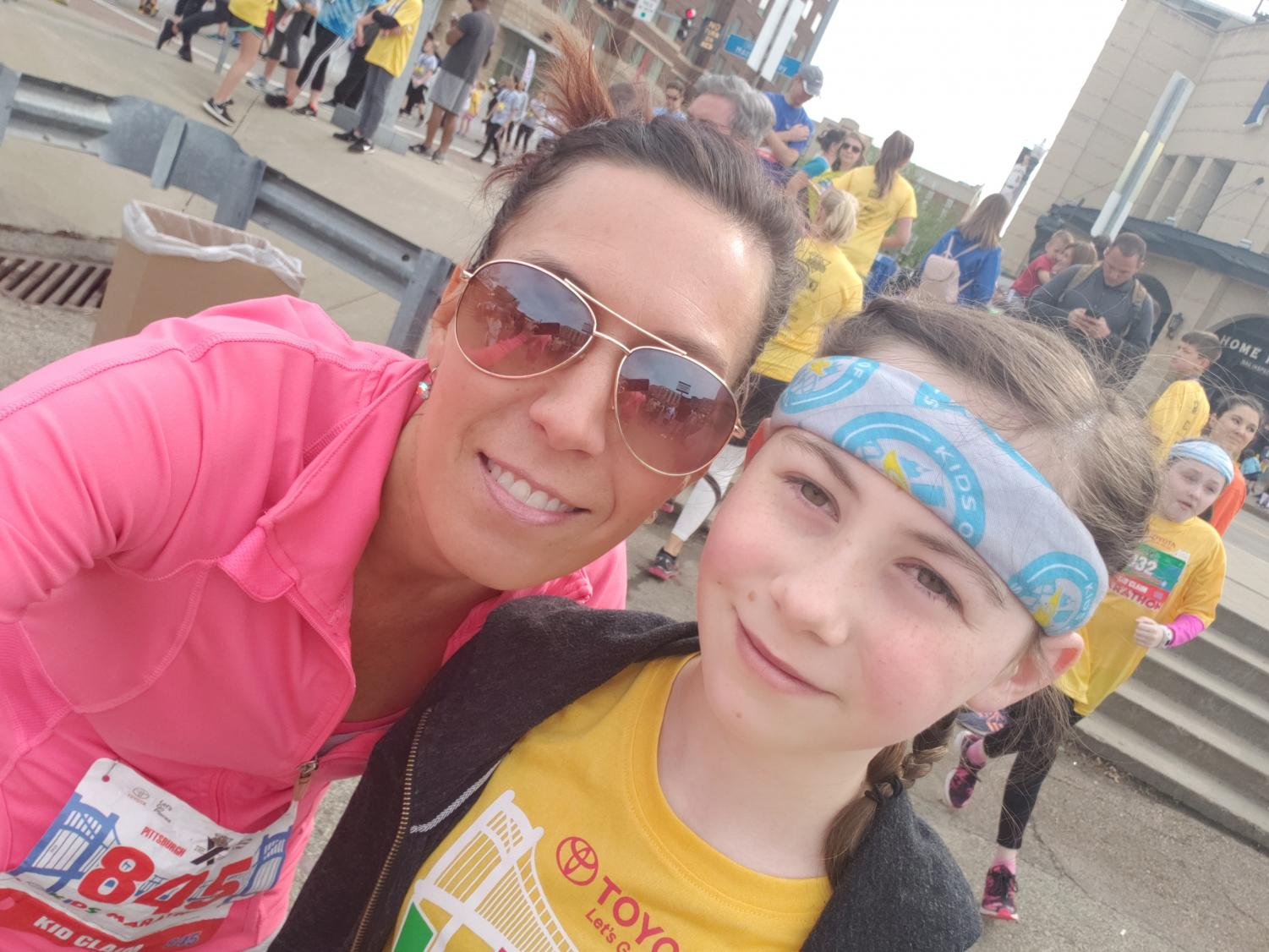 Dawson and her daughter take a selfie together at the Kids Marathon in Pittsburgh.