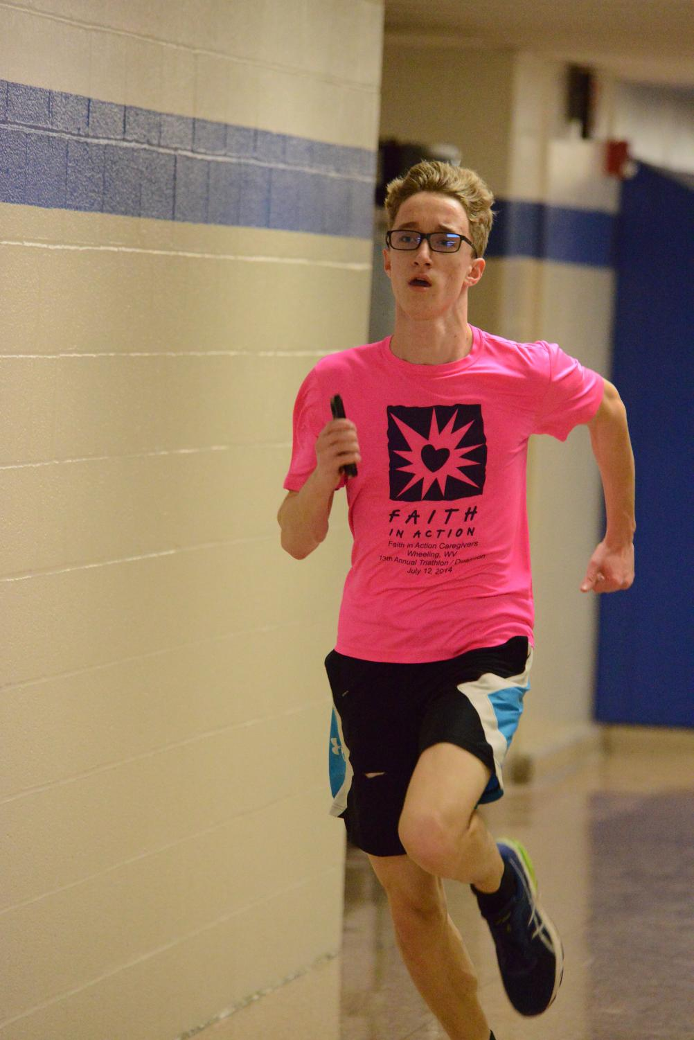 Senior Jarrett Gandy is seen training in the basement of the school, running down the hallway in the midst of the 2017-2018 season.