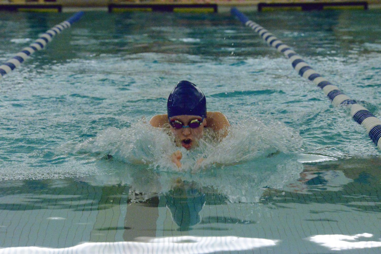 Current senior Julia Faust executes a flawless breast-stroke in a meet from last season.