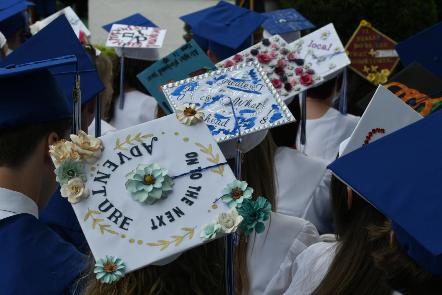 Many seniors decorate their graduation caps to celebrate their special day.
