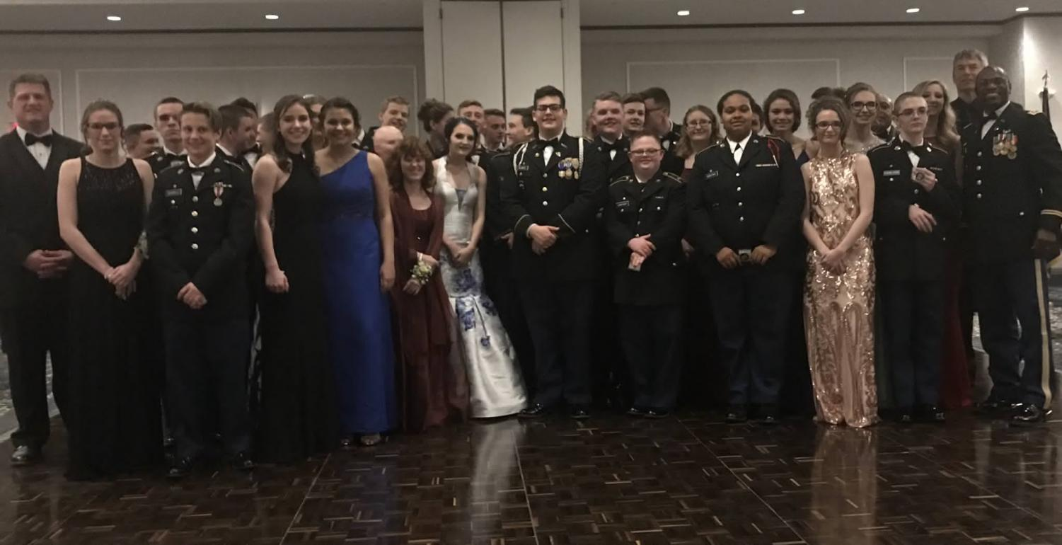Attendees of the Military Ball pose for a picture to commemorate the evening.