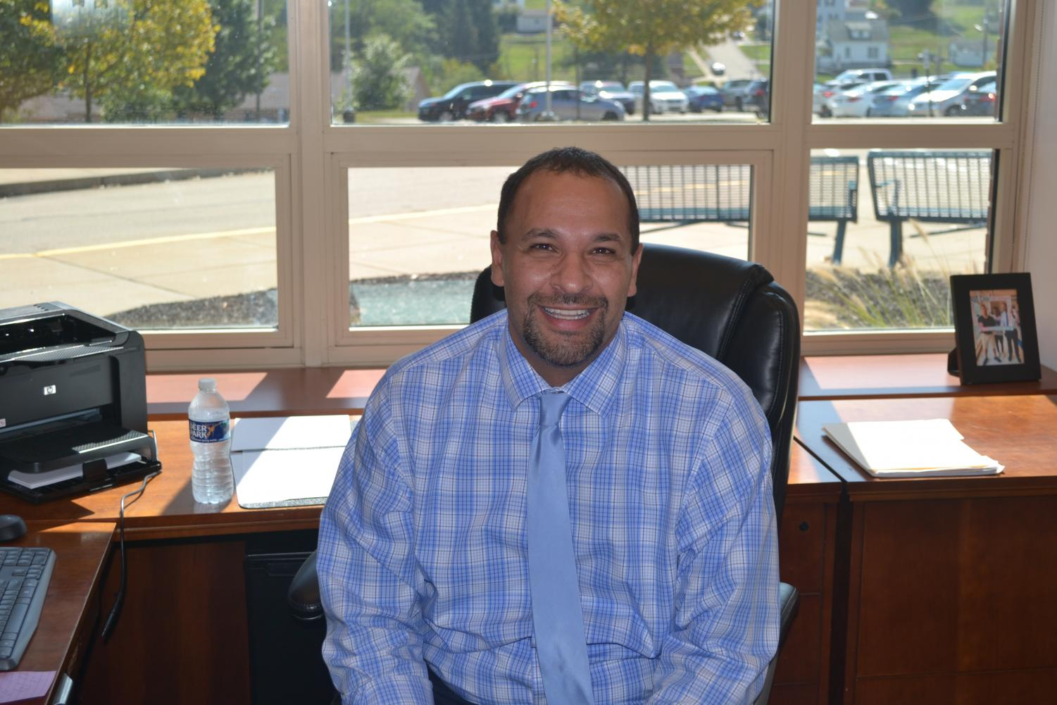 Dr. Demian smiles in his new office at THS.