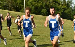 Senior Patrick Bryant and Freshman Cole Suchoza run to the finish line.