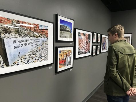 "Senior Jonathan Brodak takes time to appreciate some of the photographs in the ""Roots"" exhibit at the Holocaust Center in Pittsburgh."