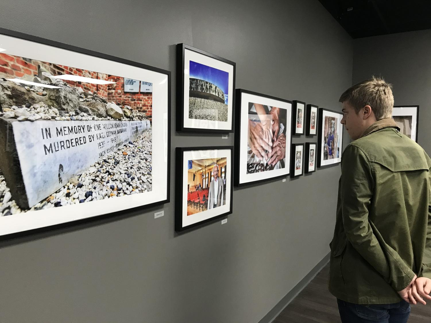 Senior Jonathan Brodak takes time to appreciate some of the photographs in the