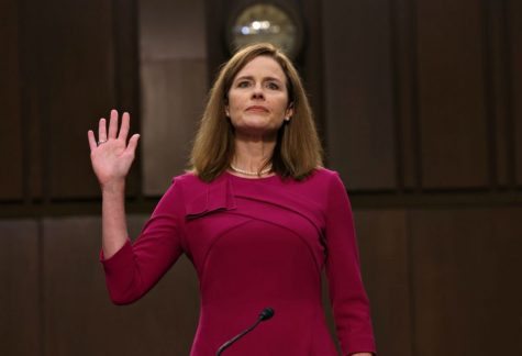 Amy Coney Barrett swears the judicial oath prior to starting the confirmation hearings.