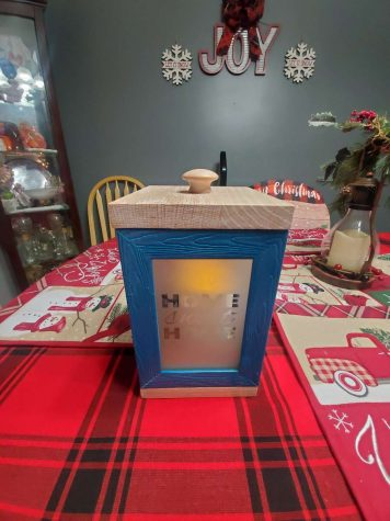 This creative gift is a lamp made from picture frames and glass that was etched to show a design. Great job, Joey!