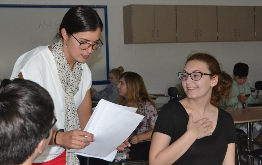Boczar interacts with her students while passing out review worksheets for the next test.  Her bubbly personality is always making her students smile.