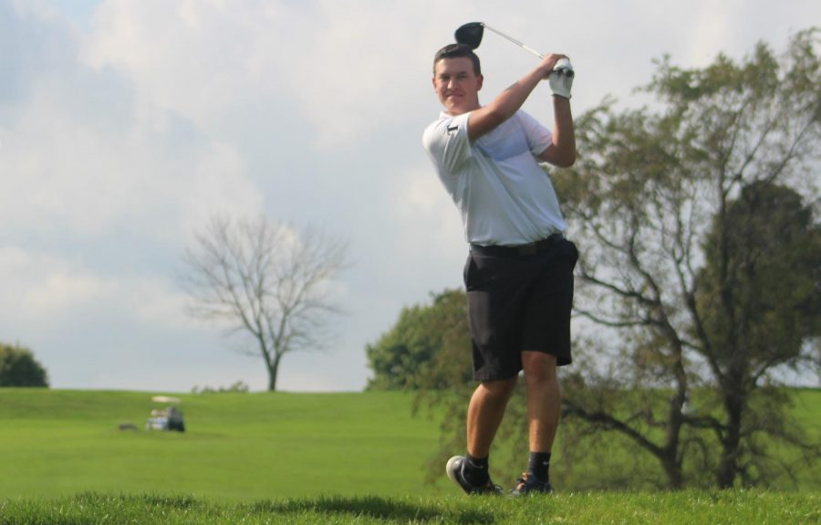 Junior Noah Johnson tees off and drives the ball down the fairway.
