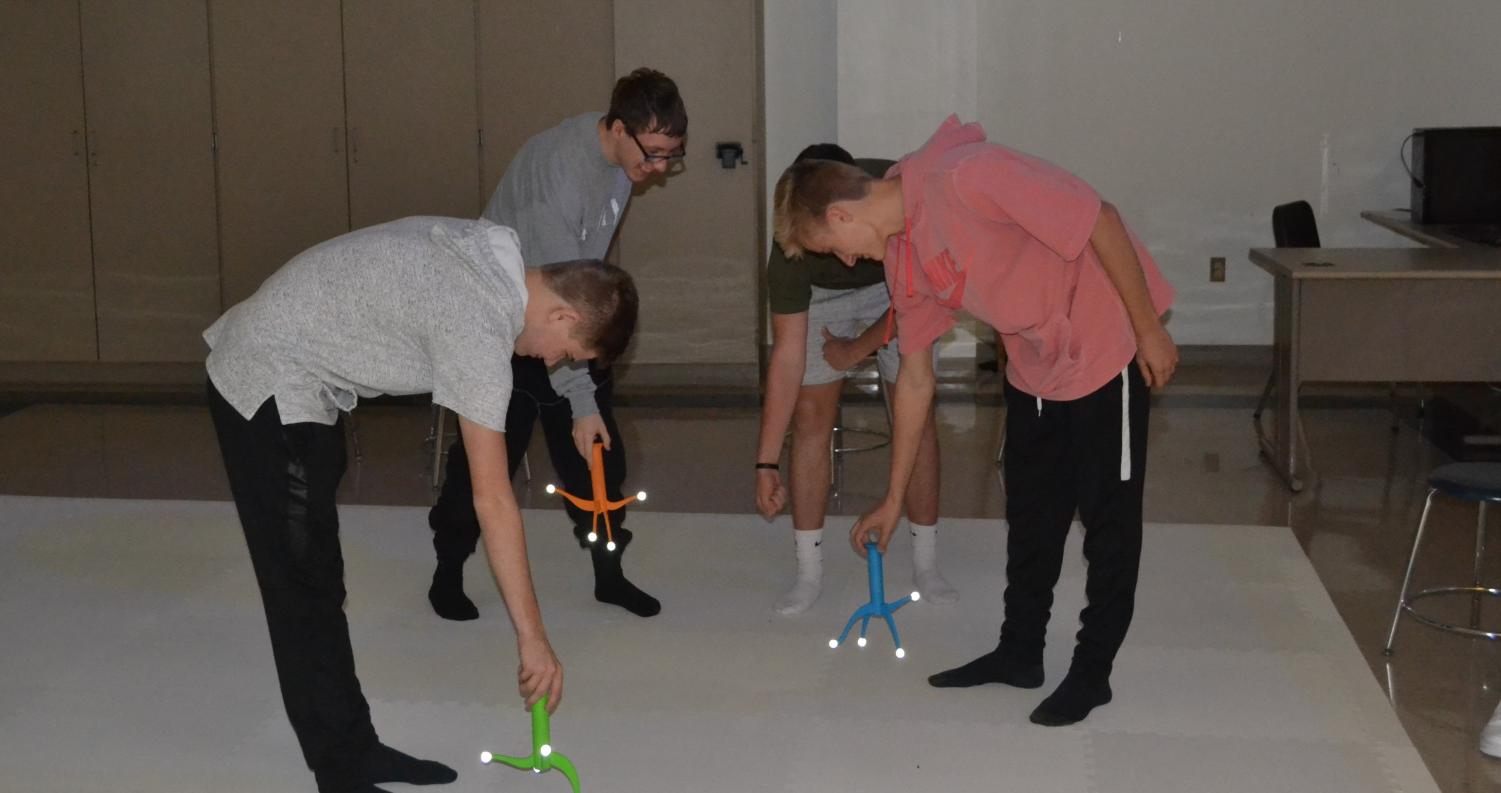 Using wands created by a 3D printer, students participate in a Virtual Lab experience at the high school.