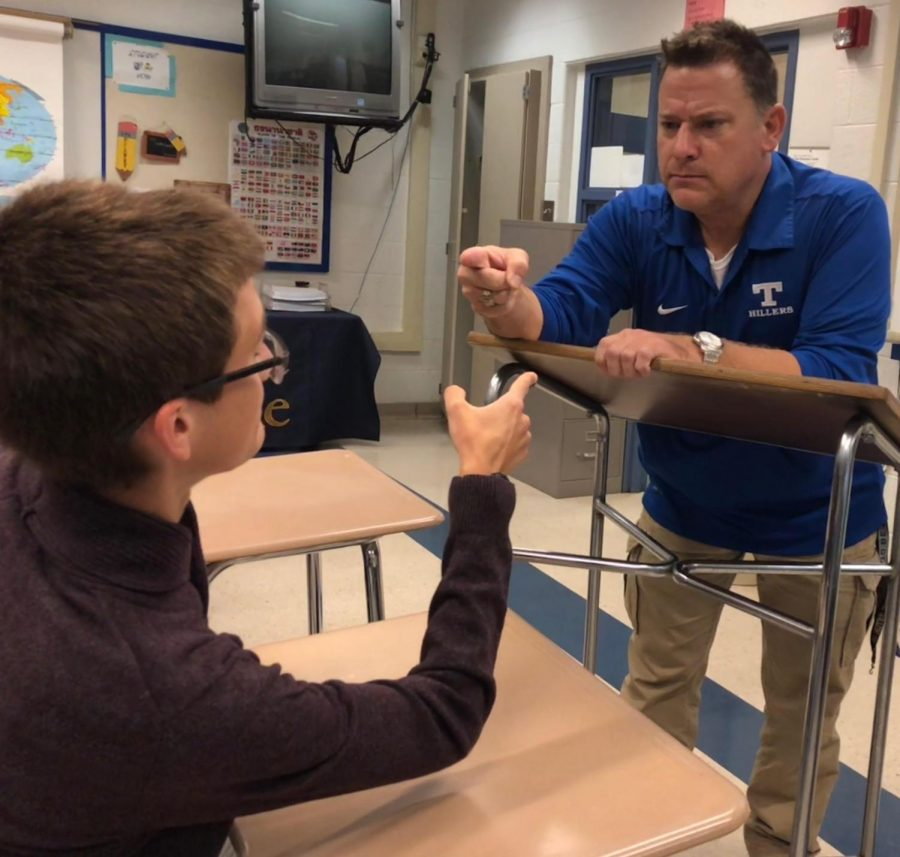 Senior Sam Halulko and AP European History teacher Mr. Polansky have a heated discussion about politics in the United States.
