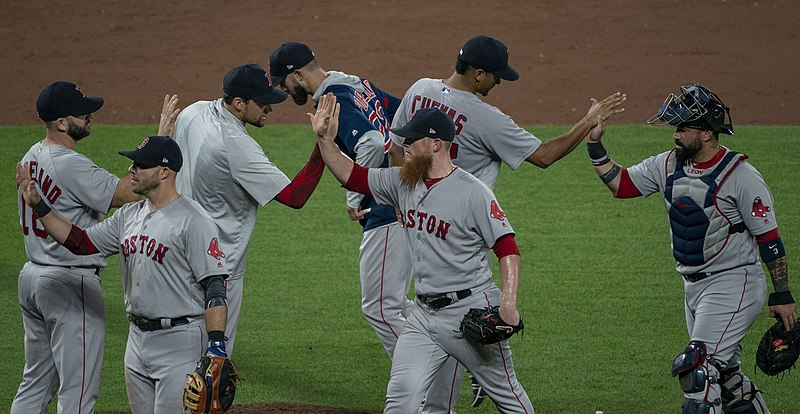 Members of the Red Sox begin their postgame celebration after a win, lead by closer Craig Kimbrel and catcher Sandy Leon.