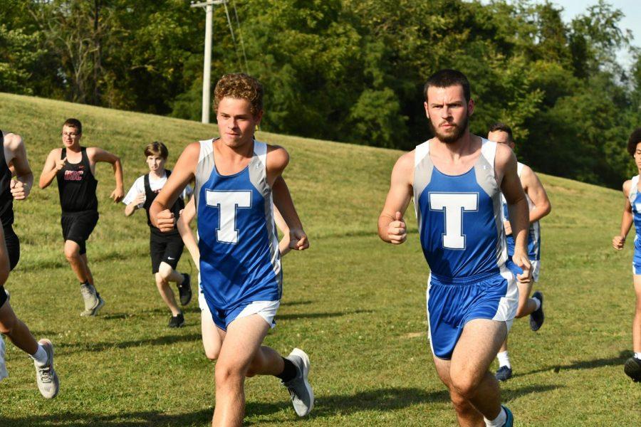 Senior Patrick Bryant and Freshman Cole Suchoza run to the finish line.
