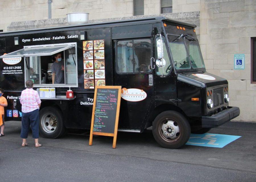 Falafel, Falafel! Hummus Pittsburgh, a popular food truck at JFK's Food Truck Sundays, serves a socially-distanced crowd.