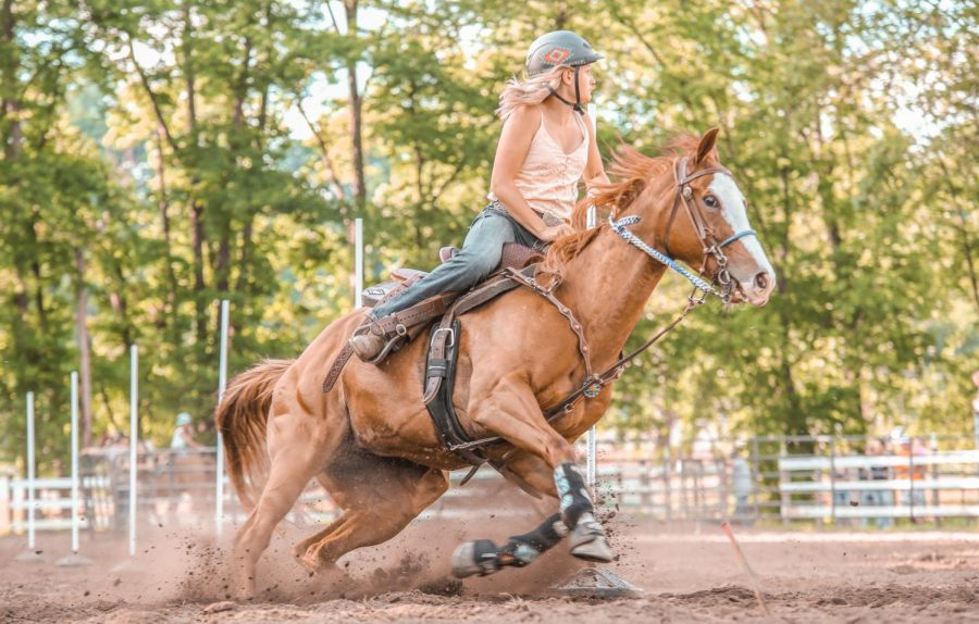 Ava Robinson competes with one of her horses.
