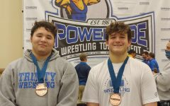 Tyson Brophy (left) and Ty Banco (right) stand together after medaling at the Powerade Tournament.