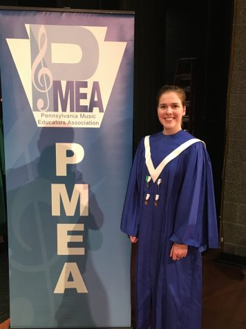 Rachel stands happily next to the PMEA sign after placing 2nd overall out of the whole District! Great job Rachel!