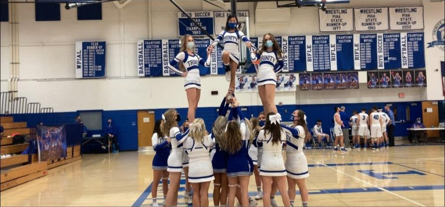 The varsity cheer team preforms a stunt at the boys basketball game. Great job Hiller cheerleaders!