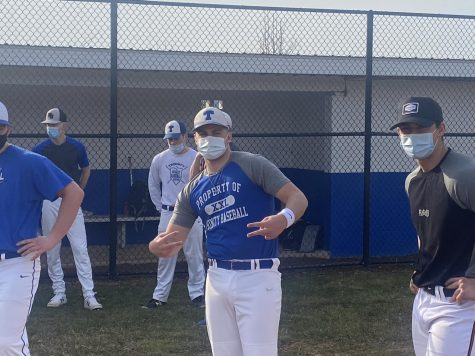 Senior Brandon Robaugh poses for a goofy picture while the baseball team gets ready to practice.