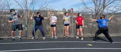 Coach Mac demonstrates how to throw javelin to a group of ready-to-learn kids!