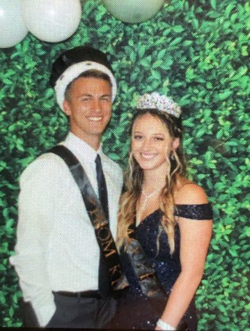 Elijah Cincinnati and Skylar Clawson smiling for winning Prom King and Queen.