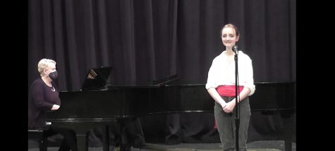 """Senior Chase Johns prepares to sing his solo of """"Her Voice"""" from the Little Mermaid."""